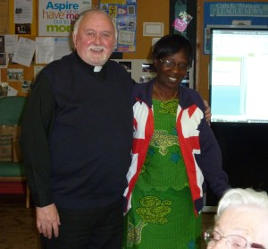 Photo of Odette Kayirere and Father Stephen Geddes