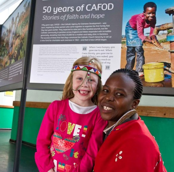 CAFOD's Kenyan Programme Officer Laureta Madegwa and a young supporter