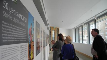 Supporters viewing the 50th Anniversary exhibition at Romero House