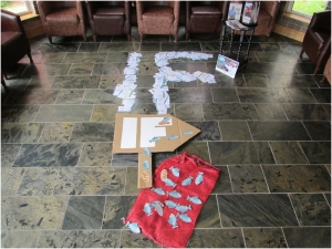 The 'IF' logo made from petitions which will be sent to David Cameron ahead of the G8 summit, as well as a handmade banner and prayers written on loaves and fishes by members of the parish.