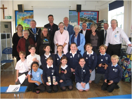 Pupils at St. Mary's RCVA Primary School, Swanage pose with CAFOD key-note speaker Bea Taylor, third row third from left, Councillor Bill Brite the Town Mayor and visitors from Swanage Town Council and Fair Trade.
