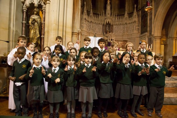 "Children from St Nicholas School signing ""Beauty for Brokenness"""