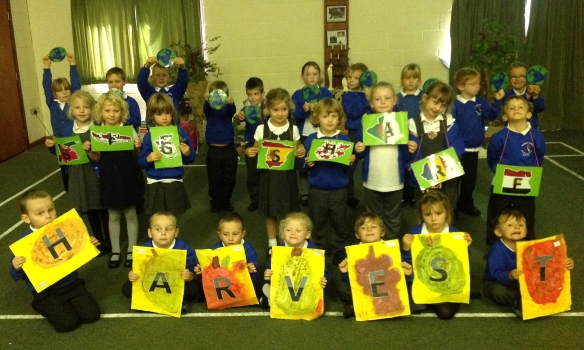 Children at St Mary's displaying their Big Share Harvest Art Work