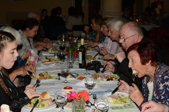 Parishioners happily tuck into their Harvest Supper.
