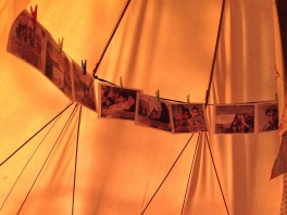 She decorated the inside of her tent with photos of refugees.