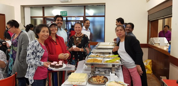 Members of the Filipino & Kerala Communities in Plymouth serving the Harvest Supper together